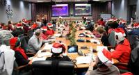 In this photo released by the US Airforce, volunteers work in the 2018 NORAD Tracks Santa Operation Center on Peterson Air Force Base in Colorado Springs, Colorado on December 24.//AFP