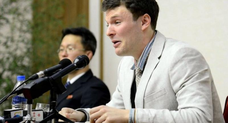 This photo taken on Feb 2016 and released by KCNA on March 1, 2016, shows US student Otto Frederick Warmbier (R), who is arrested for committing hostile acts against North Korea, speaking at a press conference in Pyongyang.//AFP