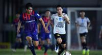 Chanathip Songkrasin, right, during a warm-up game with Thai Honda FC on Wednesday.