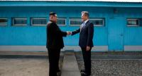 North Korea's leader Kim Jong Un (L) shakes hands with South Korea's President Moon Jae-in (R) at the Military Demarcation Line that divides their countries ahead of their summit at the truce village of Panmunjom on April 27.//AFP