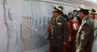 Cambodia's Prime Minister Hun Sen (L) looks at sculptures during the inauguration of the