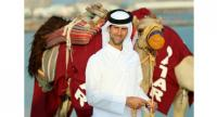 Novak Djokovic dressed in a traditional Arab costume and standing next to a camel in Doha on December 30, 2018, one day before the ATP Qatar Open.