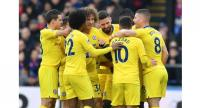 Chelsea players celebrate after Chelsea's French midfielder N'Golo Kante scores the opening goal of the English Premier League football match between Crystal Palace and Chelsea.