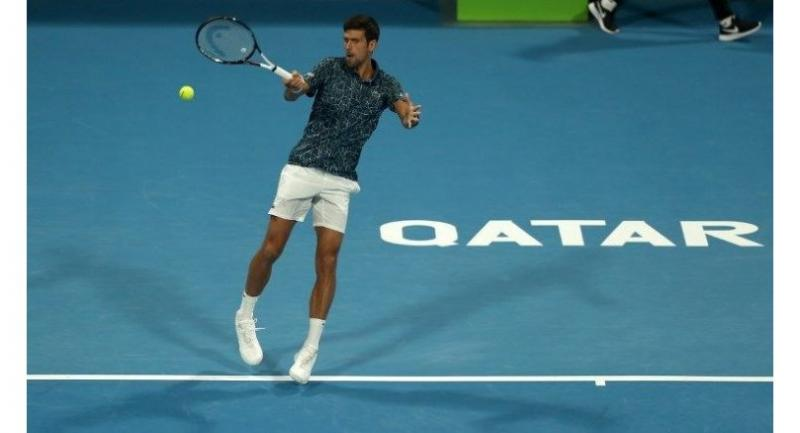 Serbia's Novak Djokovic returns the ball to Bosnia and Herzegovina's Damir Dzumhur during the ATP Qatar Open.