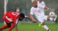 Chanathip Songkrasin, right, battles for the ball with an Omani player.