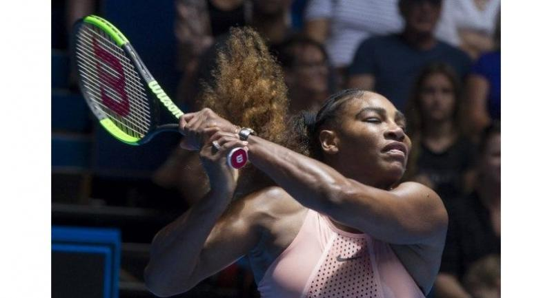 Serena Williams of the US hits a return against Katie Boulter of Britain.
