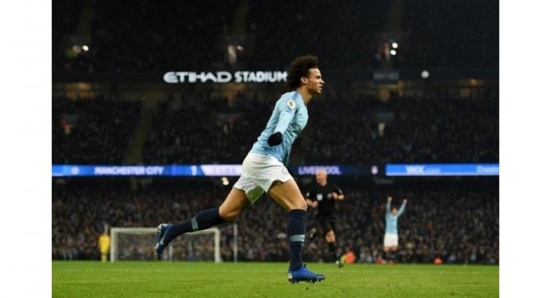 Manchester City's German midfielder Leroy Sane celebrates after scoring their second goal during the English Premier League football match between Manchester City and Liverpool.