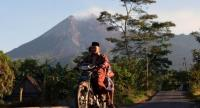 A couple in Balerante, Kemalang, Klaten, Central Java ride a motorcycle to Al Qodar Mosque for prayers on June 15, 2018. The residents of Balerante live only 3.5 kilometers from the peak of Mount Merapi.//JP