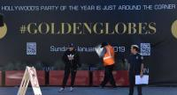 Workers and staff prepare the red carpet area for the 76th Golden Globe Awards at the Beverly Hilton hotel in Beverly Hills, California, on 4 January, 2019, to be held January 6.//AFP