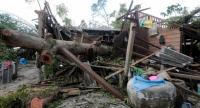 Scenes of destruction wreaked by tropical storm Pabuk, like this damaged house in Ban Chang-hoon of Nakhon Si Thammarat's Muang district, are a common sight throughout the province a day after the storm's exit.