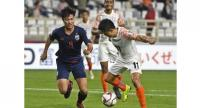 India's forward Sunil Chhetri (R) fights for the ball with Thailand's defender Chalermpong Kerdkaew during the 2019 AFC Asian Cup Group A football game .