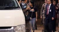 Saudi woman Rahaf Mohammed al-Qanun (C) is escorted to a vehicle by the Thai immigration officer and United Nations High Commissioner for Refugees (UNHCR) officials at the Suvarnabhumi international airport in Bangkok on January 7, 2019./AFP