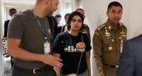 A handout photo shows Saudi Arabia woman who seeking for asylum Rahaf Mohammed al-Qunun (C) chats with Thai Immigration Police Chief Surachet Hakparn (R) and UNHCR officer (L) at the Suvarnabhumi international airport on January 7.//EPA-EFE