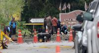 Forensic officials yesterday collect evidence from the site of a powerful car-bomb attack near a police station in Songkhla's Thepa district that injured two police officers.