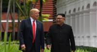 In this file photo taken on June 12, 2018 North Korea's leader Kim Jong Un (R) walks with US President Donald Trump (L) during a break in talks at their historic US-North Korea summit in Singapore.//AFP