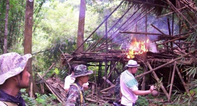 A file photo shows National Park officers at Ban Bangkloibon inside Kaeng Krachan National Park, during the 2011 operation to burn down the village and forcibly drive the Karen villagers out of their ancestral land.
