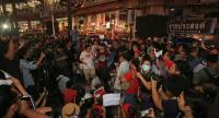 Activists hold a rally against the election delay at the Ratchaprasong Intersection in Bangkok on Tuesday.