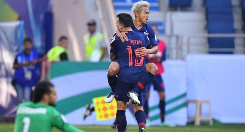 Chanathip Songkrasin, grey hair,  celebrates with Tristan Do after scoring for Thailand.