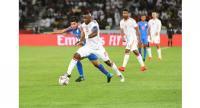 India's midfielder Anirudh Thapa (L) marks United Arab Emirates' midfielder Ismail Al Hamadi.