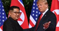 In this file photo taken on June 12, 2018 US President Donald Trump (R) gestures as he meets with North Korea's leader Kim Jong Un (L) at the start of their historic US-North Korea summit, at the Capella Hotel on Sentosa island in Singapore. --AFP