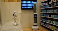Pepper,left, interacts with customers while Tally, right,  scans the shelves to monitor inventory levels in this demo from SoftBank at the Consumer Electronics Show in Las Vegas. /AFP