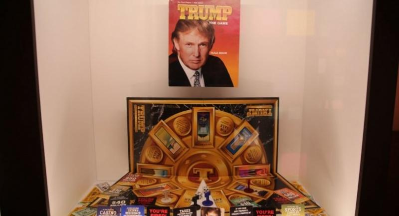 """Components of """"Trump  the Game"""", a boardgame themed around Donald Trumps's real estate business, originally released in 1989 and then again in 1990, on display at the Museum of Failure in Helsingborg, Sweden."""