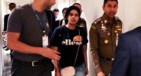 In this file photo taken on January 7, 2019, this handout picture taken and released by the Thai Immigration Bureau shows 18-year-old Saudi woman Rahaf Mohammed al-Qunun (C) being escorted by officials at the Suvarnabhumi Airport.
