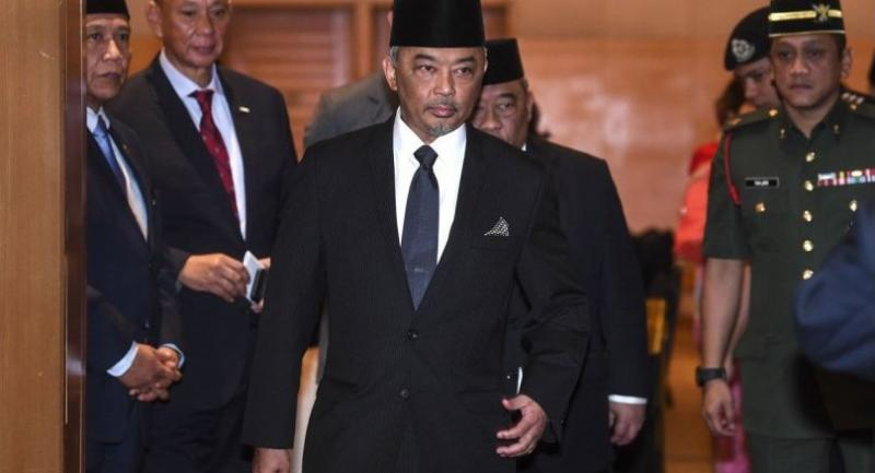 This pictures taken on January 11, 2019 shows Tengku Abdullah Shah (C) walking after a meeting in Kuala Lumpur./AFP