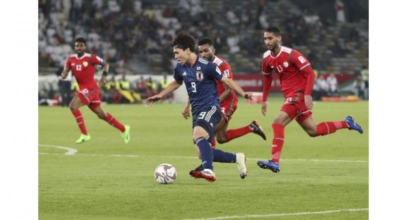 Japan's forward Takumi Minamino drives the ball during the 2019 AFC Asian Cup group F football match between Oman and Japan.