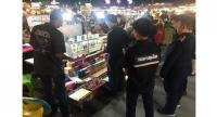Officials from the Department of Disease Control's Bureau of Tobacco Control and Office of the Consumer Protection Board arrest vendors selling ecigarettes and nicotine chargers last month at the Liab Duan night market in Bangkok's RamIndra area.