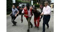 An injured man is evacuated from the Dusit2 hotel and office complex.// AFP PHOTO