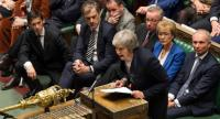 Britain's Prime Minister Theresa May makes a statement in the House of Commons in London on January 15, 2019 directly after MPs rejected the government's Brexit deal.//AFP