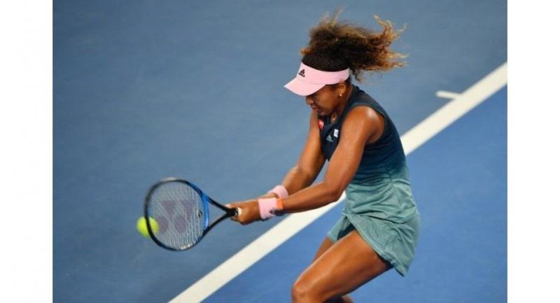Naomi Osaka hits a return against Slovenia's Tamara Zidansek.
