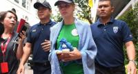 Detained Belarusian model Anastasia Vashukevich (C) known by her pen name Nastya Rybka leaves Thai immigration department in Bangkok on January 17 during her deportation together with other associates.//AFP