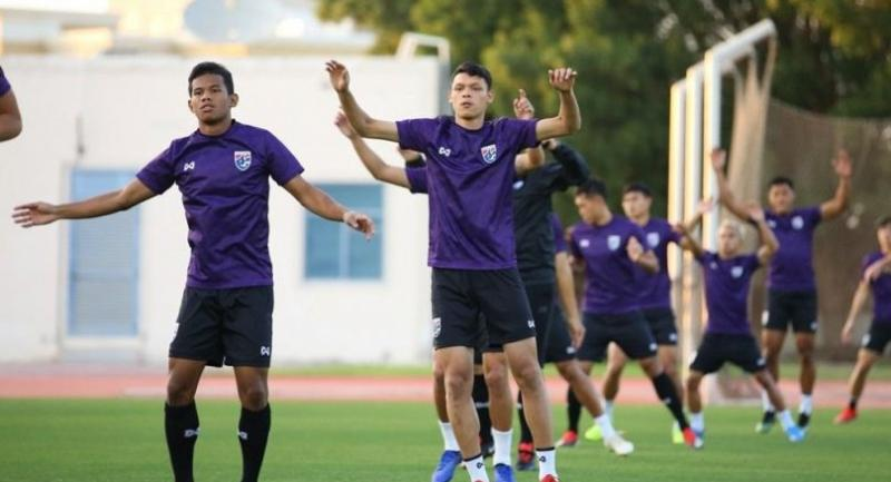 Rising to the occasion: Thailand's footballers, seen here training in Al Ain, are being urged to lift their goals by coach Sirisak Yodyadthai.
