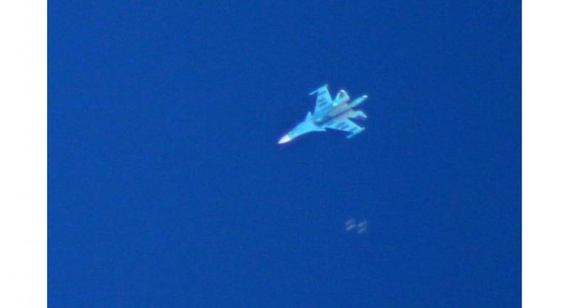 A Russian Sukhoi Su-34 fighter drops bombs over the Syrian village of Kafr Ain in the southern countryside of Idlib province on September 7, 2018.//AFP