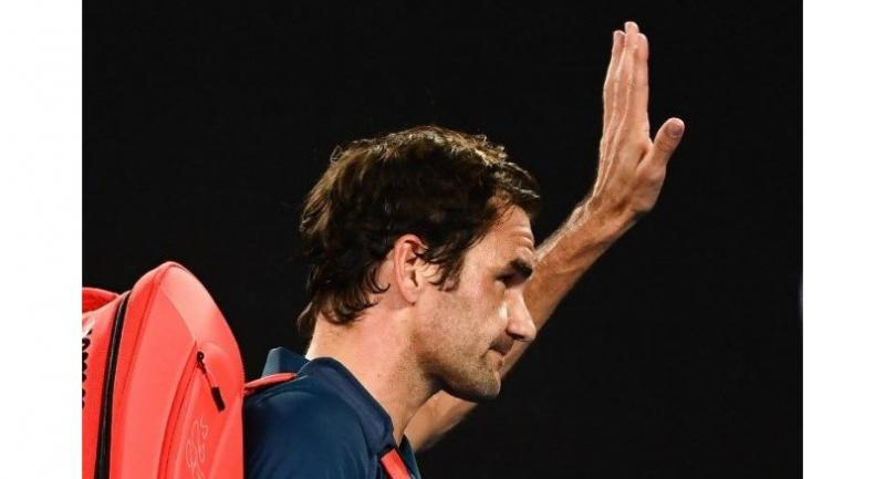 Roger Federer waves to the crowd as he leaves the court after his defeat against Greece's Stefanos Tsitsipas.