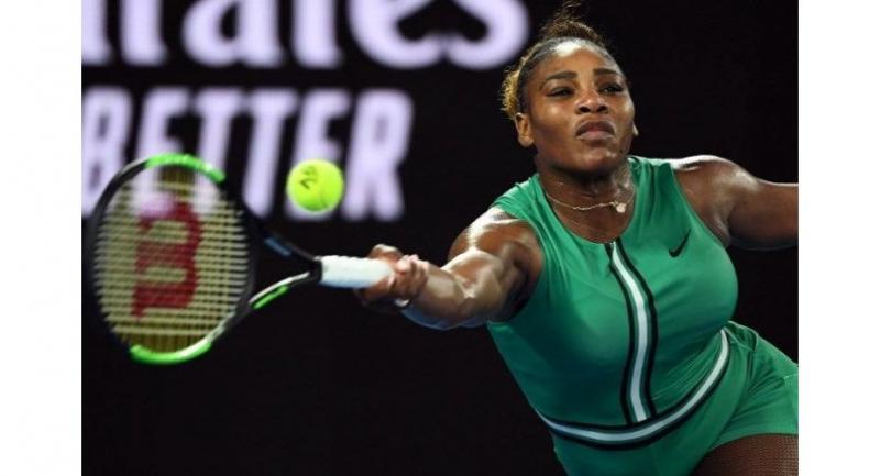 Serena Williams of the US hits a return against Romania's Simona Halep.