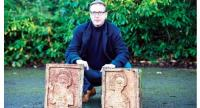 Dutch art detective Arthur Brand poses with two limestone Visigoth reliefs from the 7th century in north London.//AFP