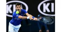 Serbia's Novak Djokovic hits a return against France's Lucas Pouille.
