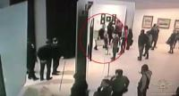 An image grab taken from a video footage released by the Russian Interior Ministry on January 28, 2018, shows a man, stealing a famous painting by Arkhip Kuindzh during an exhibition at the Tretyakov Gallery in Moscow on January 27, 2018. /AFP PHOTO