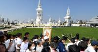 Tens of thousands of mourners on Monday pay their respects at a temporary crematorium at Buddhamonton Isan on the grounds of Wat Nong Waeng, Muang district, Khon Kaen province.