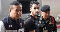 File photo: Hakeem Alaraibi (C), a former Bahrain national team footballer with refugee status in Australia, is escorted by immigration police to a court in Bangkok on December 11, 2018. // AFP PHOTO