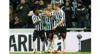 Newcastle United's Scottish midfielder Matt Ritchie (C) celebrates with teammates. AFP