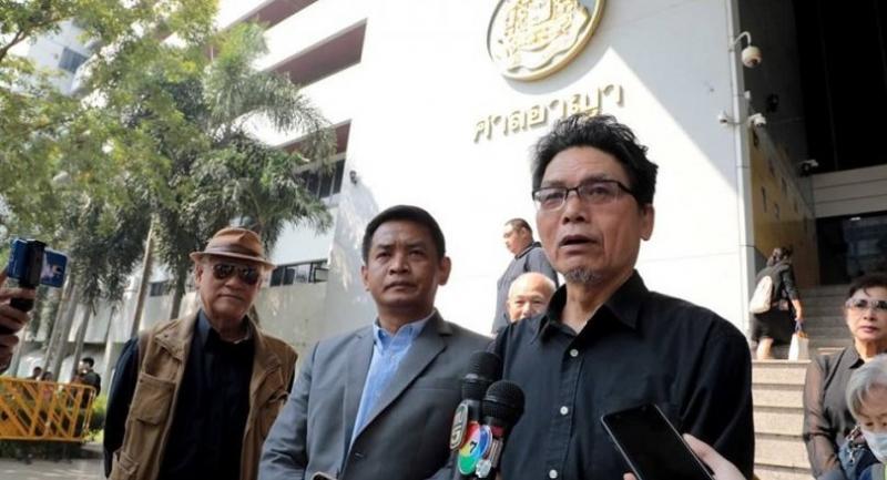 Pipob Thongchai, Suriyasai Katasila and Somkiat Pongpaiboon talk to reporters in front of a Court on Wednesday//Photo : Kunlaphun Siripimamporn