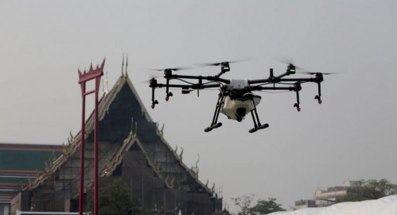 Agricultural drones spray a water-based solution into the air during an operation aimed to ease the effects of heavy smog in Bangkok yesterday.