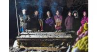 Sacred ritual: Thang's family members lighting incense on his unearthed coffin during the reburial ceremony at a cemetery on the outskirts of Hanoi.//AFP