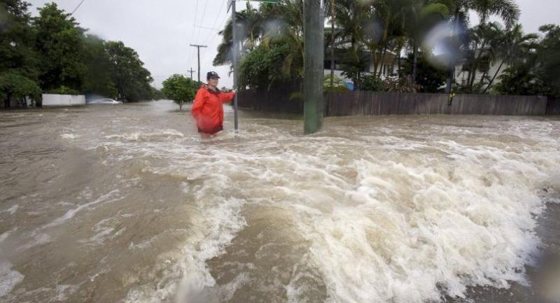 Amelia Rankin in flooded waters in Hermit Park, Townsville, Queensland, Australia on Sunday. // EPA-EFE PHOTO