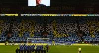 Players from both sides and supporters observe a moment of reflection to honour Cardiff's Argentinian striker Emiliano Sala before the English Premier League football match between Cardiff City and Bournemouth at Cardiff City Stadium. on Feb 2.//AFP