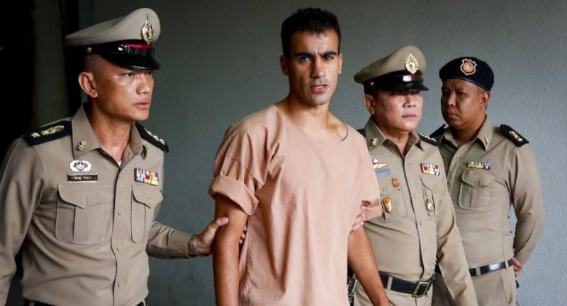 Bahraini soccer player with Australian refugee status Hakeem Al-Araibi (2-L) walks while escorted by Thai prison officers following an extradition hearing at the Criminal Court in Bangkok on Monday.// EPA-EFE PHOTO